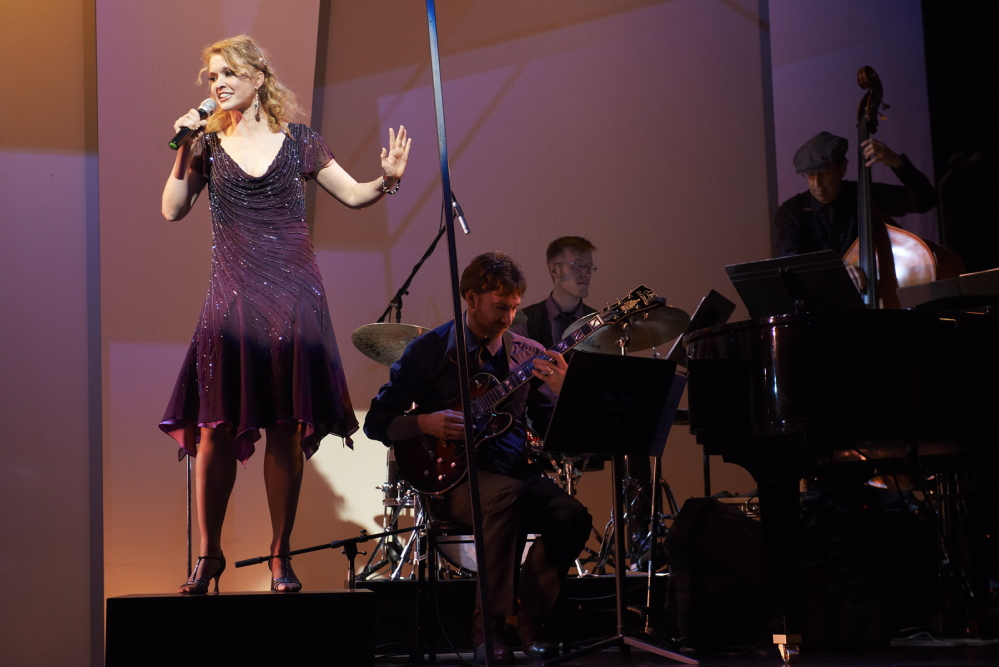 The Chanteuse (Amy Bodnar) is accompanied by the production's live band featuring Pat Keane on guitar, Jacob Forbes on drums, Jim Lyden on bass and, not pictured, Hans Indigo Spencer on piano and saxophone.