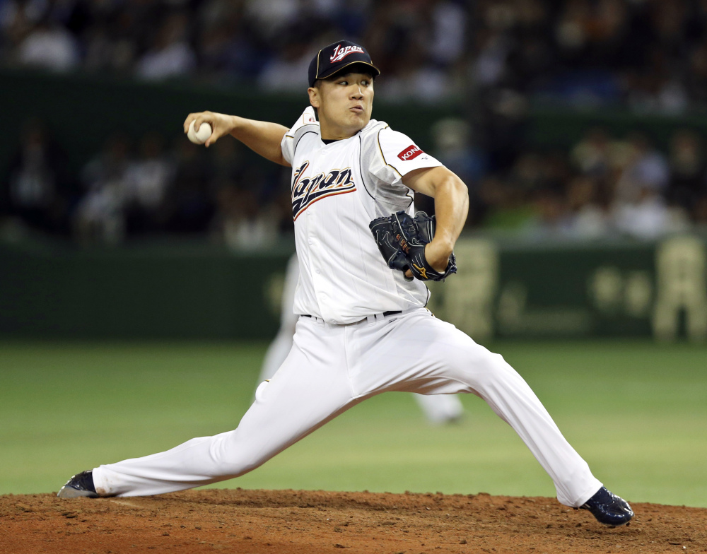 Japan's Masahiro Tanaka pitches against the Netherlands in the fifth inning of a World Baseball Classic second round game at Tokyo Dome in Tokyo.