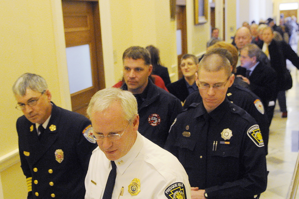 Public safety workers line up in the State House on Wednesday to testify in favor of saving municipal revenue sharing that could be cut.