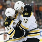 It's a bear hug between the Boston Bruins' Jarome Iginla, right, and Torey Krug following Iginla's third-period goal during Saturday's 6-1 victory at Philadelphia.