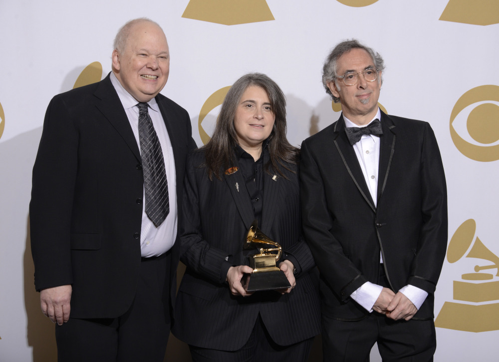 "From left, Bob Ludwig, Teri Landi and Steve Rosenthal pose in the press room with the award for best historical album for ""Charlie Is My Darling - Ireland 1965"" at the 56th annual GRAMMY Awards at Staples Center on Sunday, Jan. 26, 2014, in Los Angeles. (Photo by Dan Steinberg/Invision/AP)"