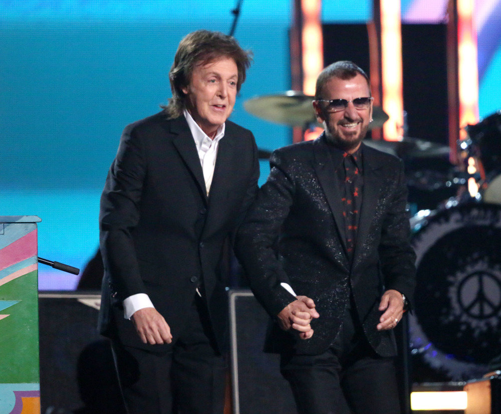 Paul McCartney, left, and Ringo Starr take a bow after performing together in the Grammy Awards show.