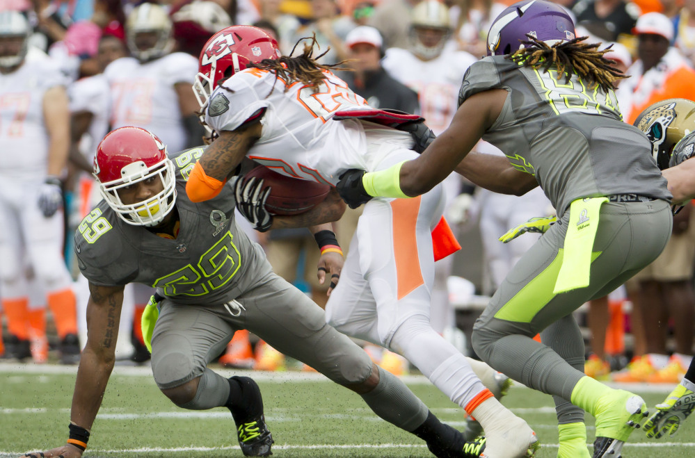 Kansas City Chiefs wide receiver Dexter McCluster of Team Rice is tackled by Chiefs safety Eric Berry, left, and Minnesota Vikings wide receiver Cordarrelle Patterson of Team Sanders on a punt return in the third quarter of Sunday's Pro Bowl, won by Team Rice 22-21.