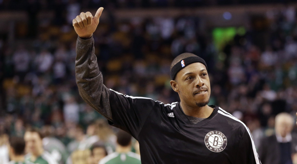 All the best, Paul Pierce signals to a packed TD Garden that served as his NBA home for 15 splendid seasons before he was dealt to Brooklyn.