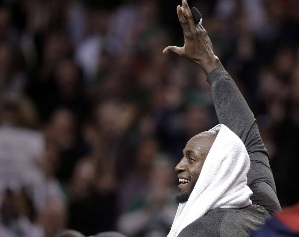 Kevin Garnett acknowledges the Boston crowd during an emotional tribute to him during the first half of Sunday's game.