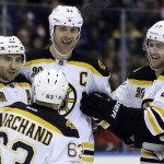 Boston's Zdeno Chara, center, celebrates a goal with Patrice Bergeron, left, Dougie Hamilton, right, and Brad Marchand in Monday's win over the Islanders.