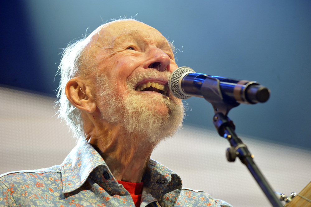 In this Sept. 21, 2013, photo shows Pete Seeger performs on stage during the Farm Aid 2013 concert at Saratoga Performing Arts Center in Saratoga Springs, N.Y.