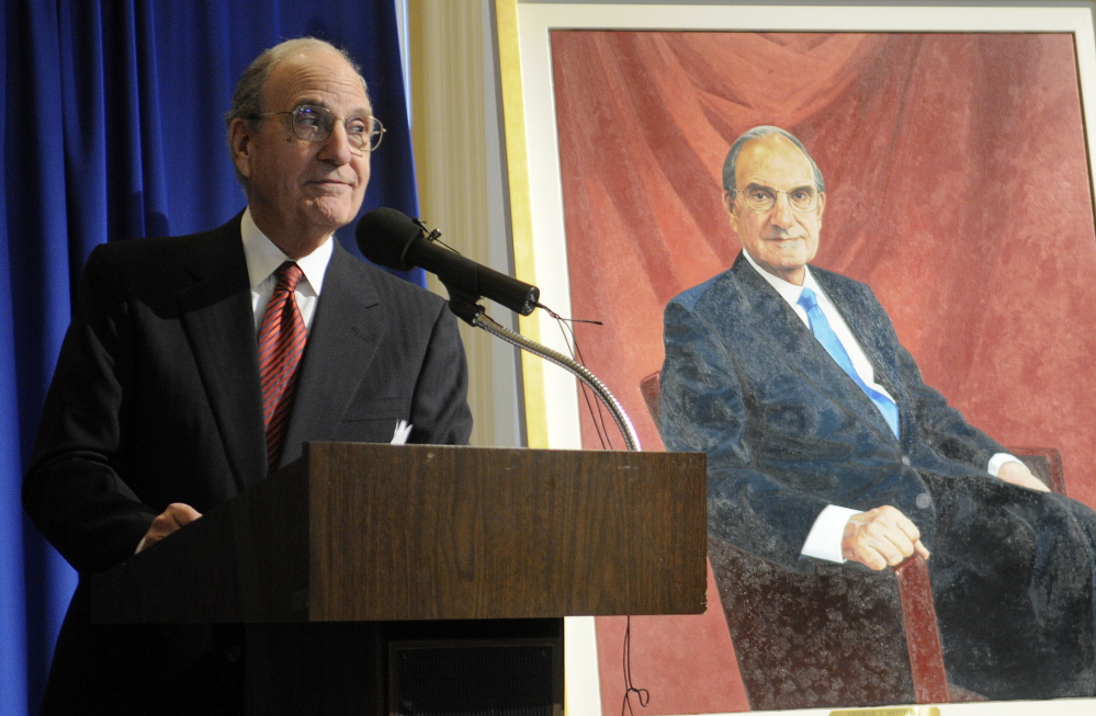 Former U.S. Sen. George Mitchell thanks supporters Tuesday after unveiling his official portrait at the State House in Augusta.
