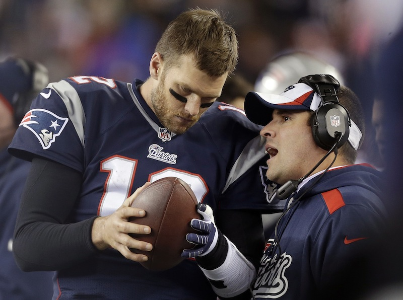 In this Nov. 3, 2013, file photo, New England Patriots offensive coordinator Josh McDaniels, right, talks to quarterback Tom Brady during the fourth quarter of an NFL football game against the Pittsburgh Steelers in Foxborough, Mass. No name stirs up quite as much angst and anger around Denver as McDaniels. The former Broncos coach, now offensive coordinator for the Patriots, left havoc in the wake of his two-year stint in Denver, and has a chance to leave another scar when the Patriots meet the Broncos in the AFC championship game on Sunday.