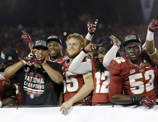 Florida State players celebrate after the NCAA BCS National Championship college football game against Auburn Monday in Pasadena, Calif. Florida State won 34-31.
