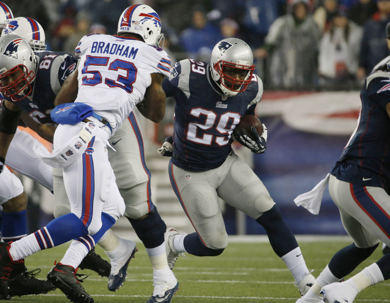 New England Patriots running back LeGarrette Blount (29) runs past Buffalo Bills linebacker Nigel Bradham (53) on Dec. 29 in Foxborough, Mass.