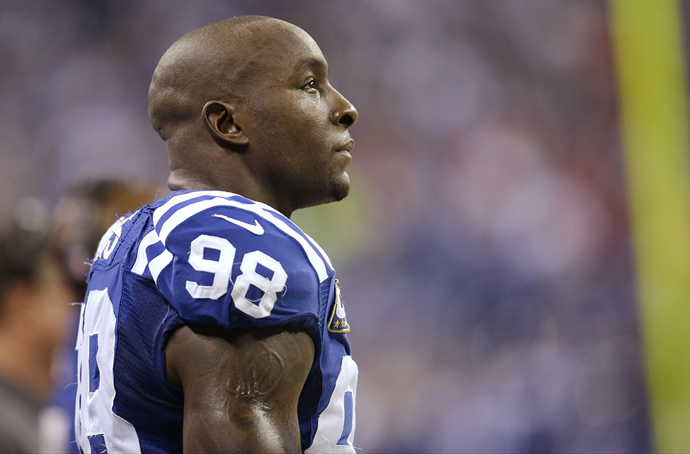 Indianapolis Colts outside linebacker Robert Mathis (98) watches action against the Kansas City Chiefs during the first half of an NFL wild-card playoff football game Saturday, Jan. 4, 2014, in Indianapolis.