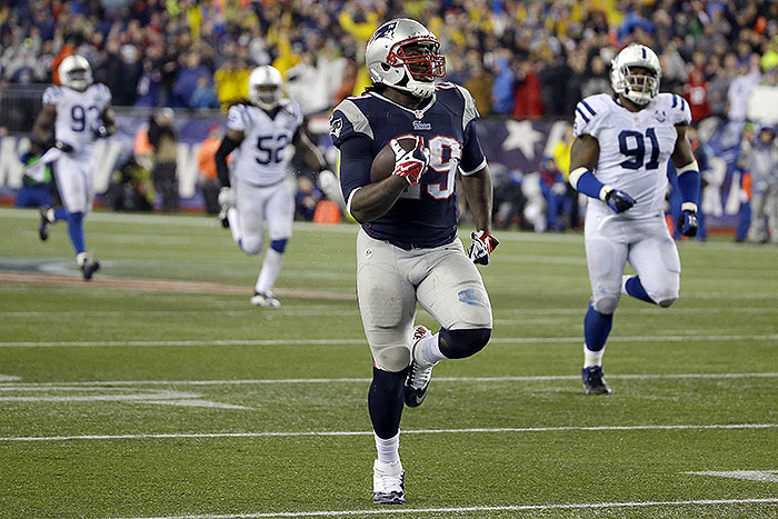 New England Patriots running back LeGarrette Blount heads downfield for a 75-yard touchdown run in the second half against the Indianapolis Colts Saturday. NFLACTION13;