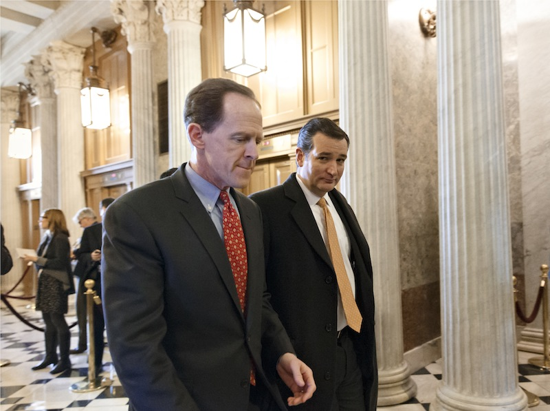 Sen. Pat Toomey, R-Pa., left, and Sen. Ted Cruz, R-Texas, right, arrive at the Senate on Capitol Hill in Washington, Tuesday, Jan. 7, 2014, for a procedural vote on legislation to renew jobless benefits for the long-term unemployed. The vote was 60-37 to limit debate on the legislation, with a half-dozen Republicans siding with the Democrats on the test vote.