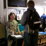 "A Maine National Guard recruiter talks to a student at the ""Thinking Outside the Box"" college and career fair at Portland Arts and Technology High School in March 2013."