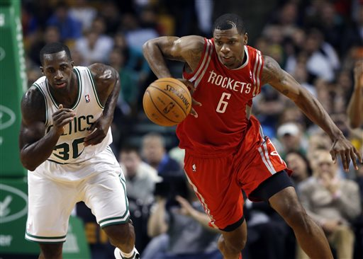 Houston Rockets forward Terrence Jones chases down a loose ball against Boston Celtics forward Brandon Bass in Boston on Monday night.