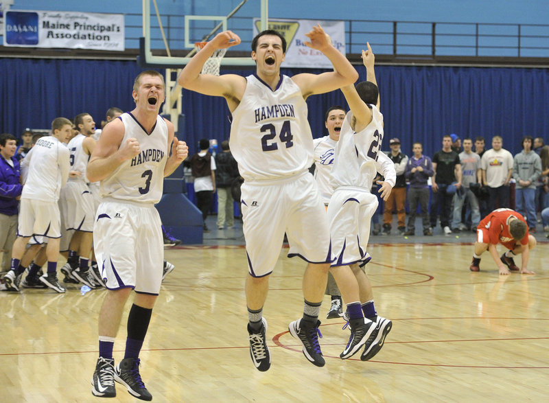 In this March 2013 file photo, Tyler Norris, 24, starts the celebration for Hampden Academy wins the Class A boys' basketball state championship. A dispute between Time Warner Cable and trustees of the Cumberland County Civic Center has resulted in MPBN announcing it will be unable to televise the Class A state championship games on March 1.