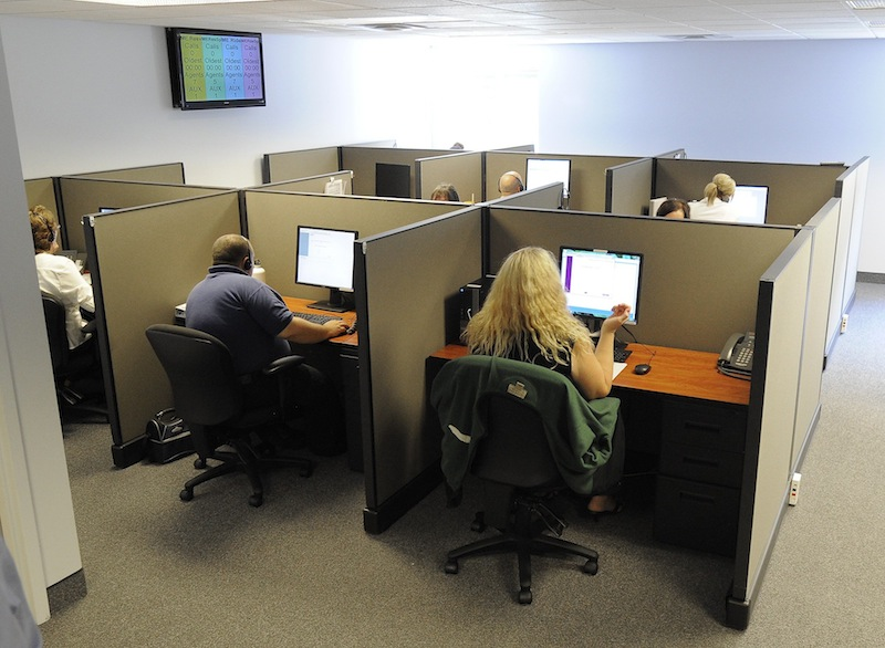 In this August 2013 file photo, a call center in Kennebunk. Labor unions are urging Maine lawmakers to deny taxpayer-funded incentives to businesses that move their call center operations overseas. LogistiCare