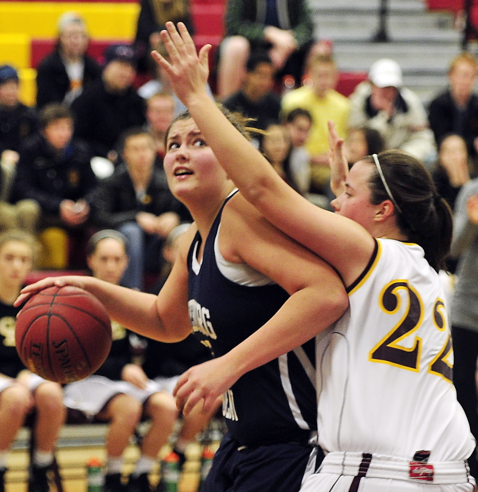 Skye Dole of Fryeburg Academy attempts to muscle past Ashley Tinsman of Cape Elizabeth for a shot Friday night during Fryeburg's 59-38 victory. Dole scored 12 points as the Raiders improved to 9-7. Cape Elizabeth is 8-8.