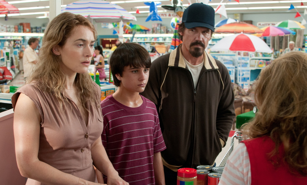 "Kate Winslet, Gattlin Griffith and Josh Brolin in ""Labor Day."""