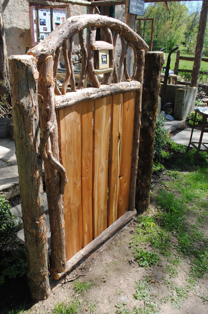 David Hughes created this 4-foot-tall garden gate using native Eastern red cedar and Moravian tiles.