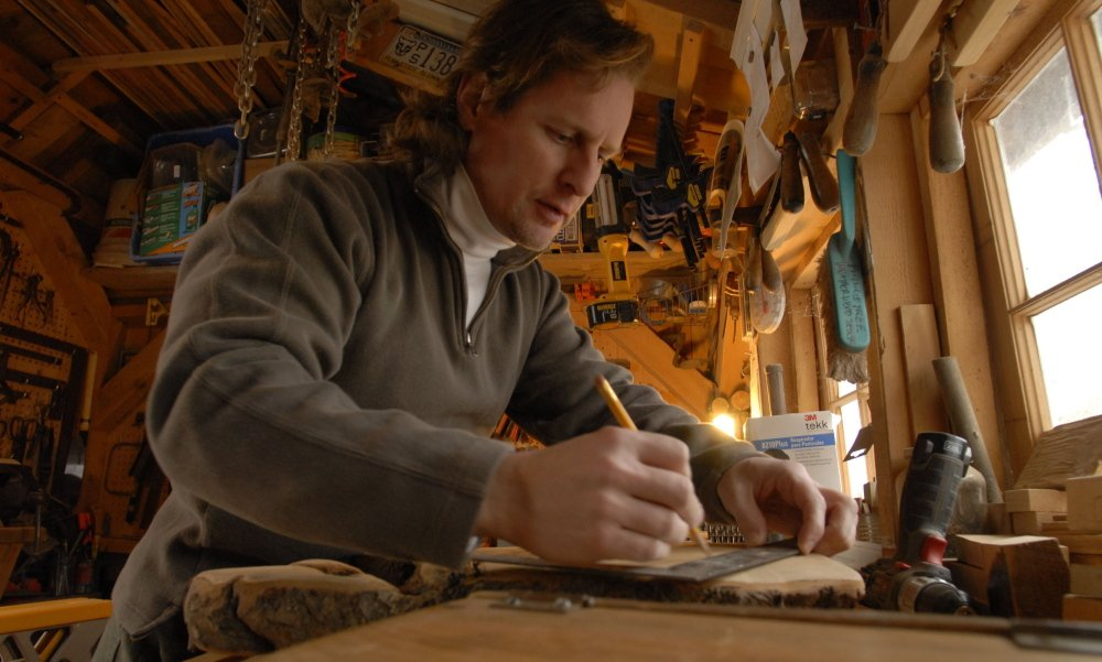 Landscape architect David Hughes works on a piece of wood for a project at his Buckingham, Pa., woodshop.