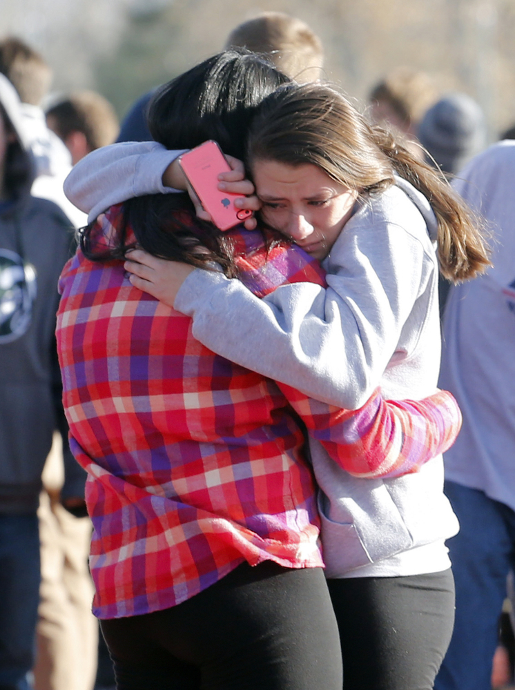 Students comfort each other outside of Arapahoe High School after a shooting on the campus in Centennial, Colo., on Dec. 13. Experts say the rate of school shootings is statistically unchanged since the mid- to late- 1990s.