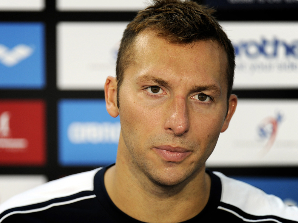 Ian Thorpe appears at a news conference after failing to qualify for the men's 100-meter butterfly of the Swimming World Cup in Singapore in this Nov. 5, 2011, photo.