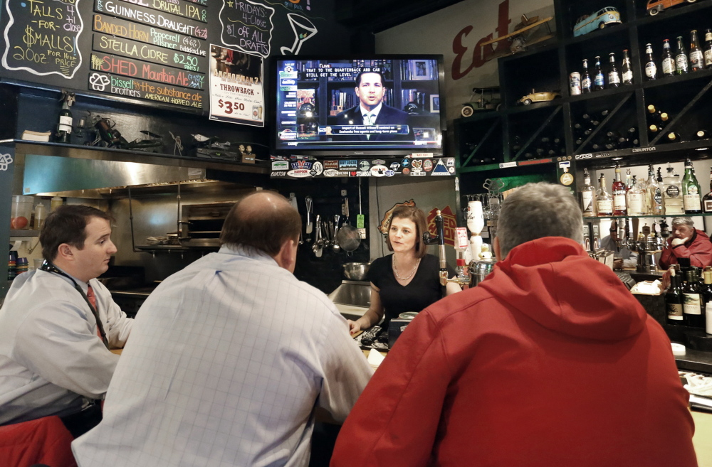 Jenn Roberge talks with patrons Monday at Shay's Grill Pub in Portland. State inspectors seem to be stepping up enforcement of a 1937 law that prohibits posting alcohol content on signs and menus.