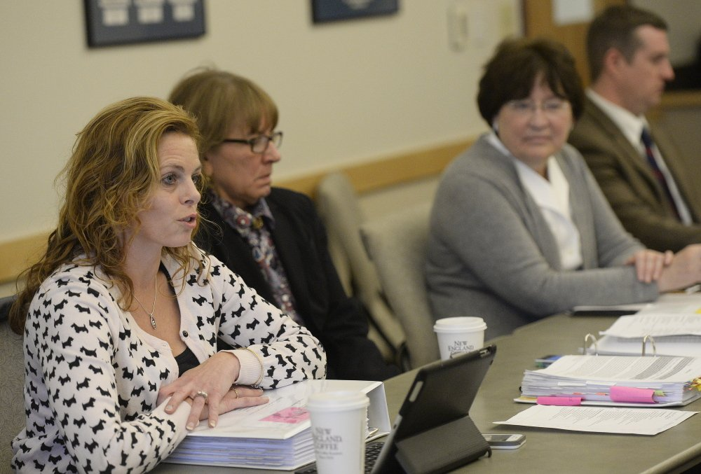 Amy Volk, a member of the board of Maine Connections Academy, addresses the state Charter School Commission on Monday. Volk, a state representative, assured commissioners the academy's local board would be independent.