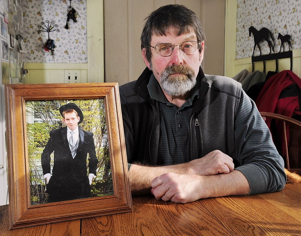 "Henry ""Skip"" Gates, of Skowhegan, sits next to a photo of his son, Will, who died after snorting heroin at college. Gates plans to testify in favor of a Narcan-access bill."