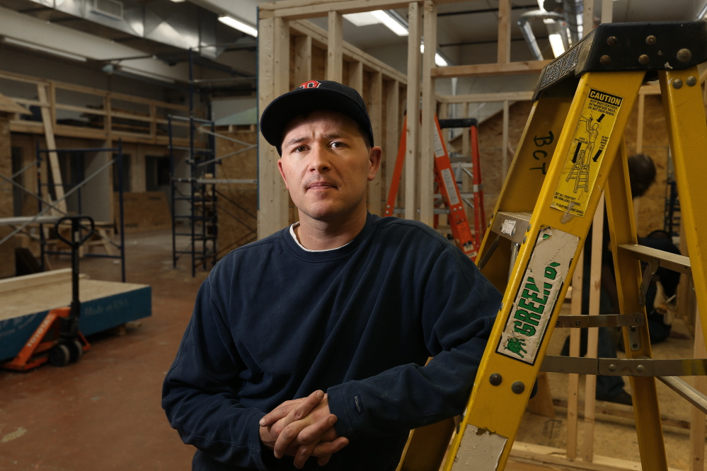 Travis Bentley works during a building construction class at Central Maine Community College in Auburn on Friday, Jan. 31, 2014. Bentley is a graduate of Veterans Treatment Court.