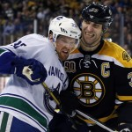 Boston Bruins defenseman Zdeno Chara, right, pushes against Vancouver Canucks center Henrik Sedin during the third period of Tuesday's game in Boston.