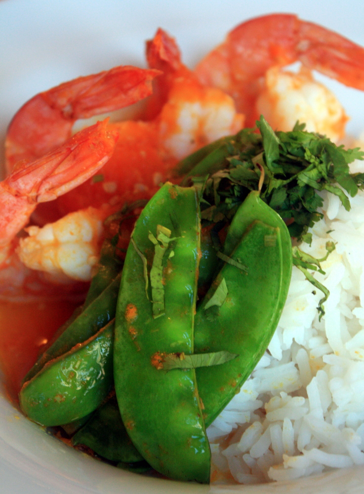 Yellow Tomato, Ginger and Lemongrass Shrimp over Coconut Rice brings color and heat to midwinter dining.