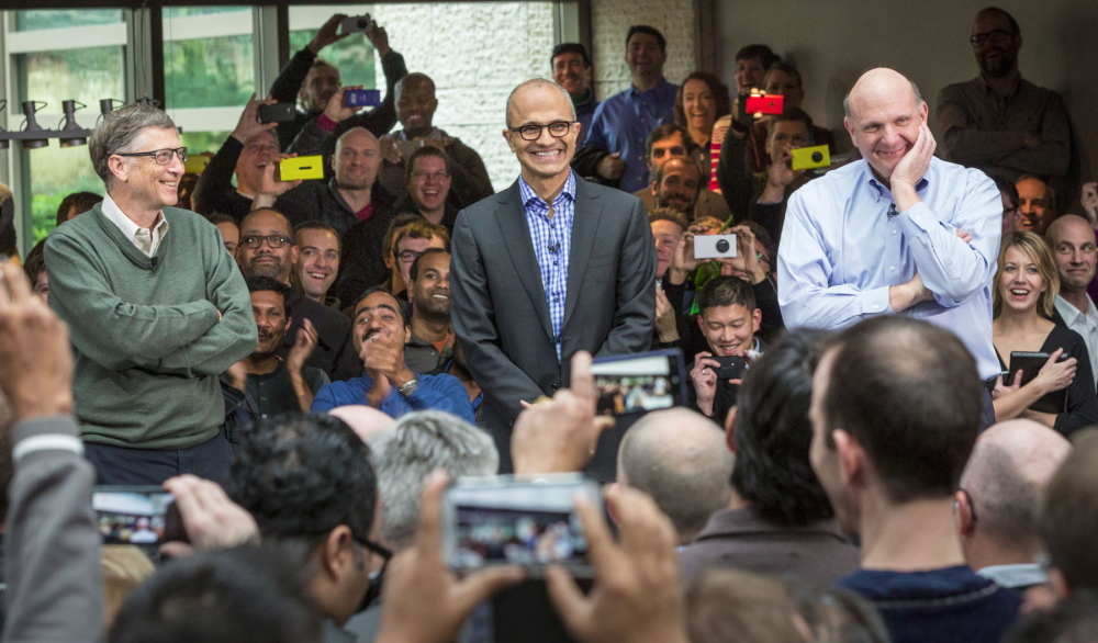 Satya Nadella, center, Microsoft's next CEO, addresses employees along with company founder Bill Gates, left, and soon-to-retire CEO Steve Ballmer on the company's campus in Redmond, Wash.