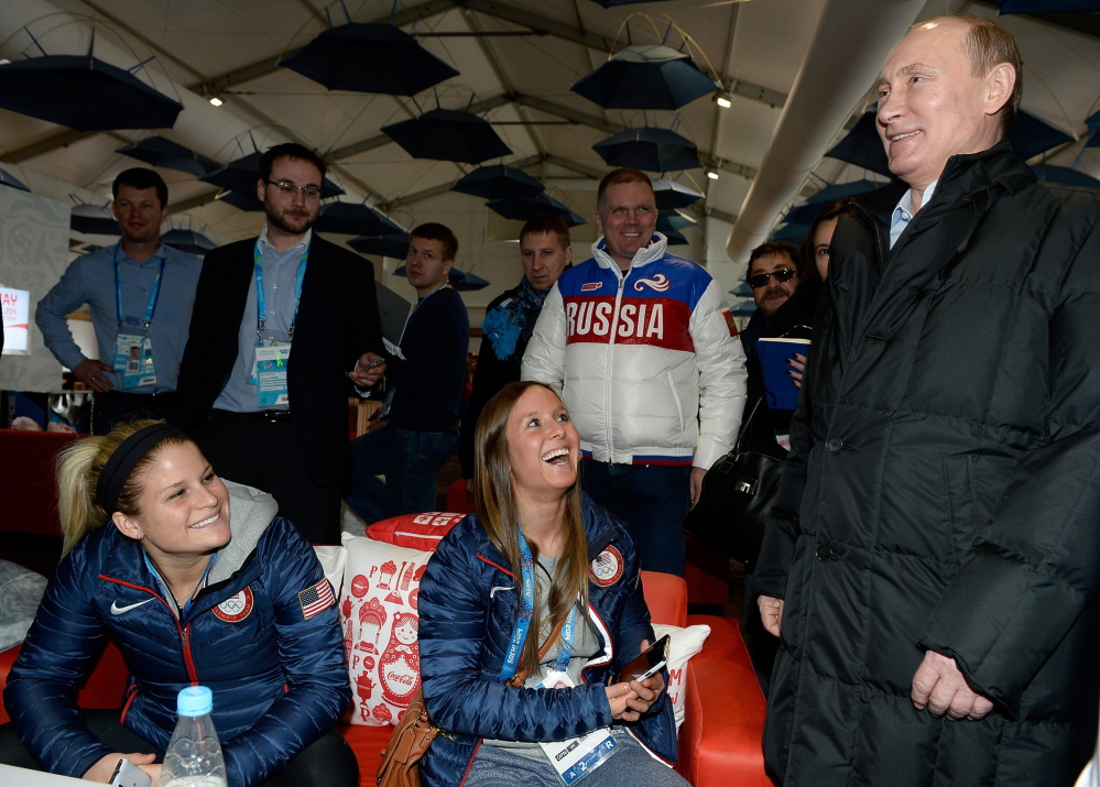 Russian President Vladimir Putin meets with athletes from the United States while visiting the Athletes Village in the Coastal Cluster ahead of the Sochi 2014 Winter Olympics on Wednesday.