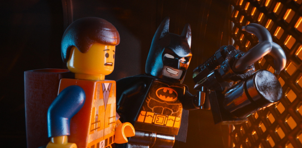 Emmet, voiced by Chris Pratt, left, and Batman, voiced by Will Arnett, in a scene from