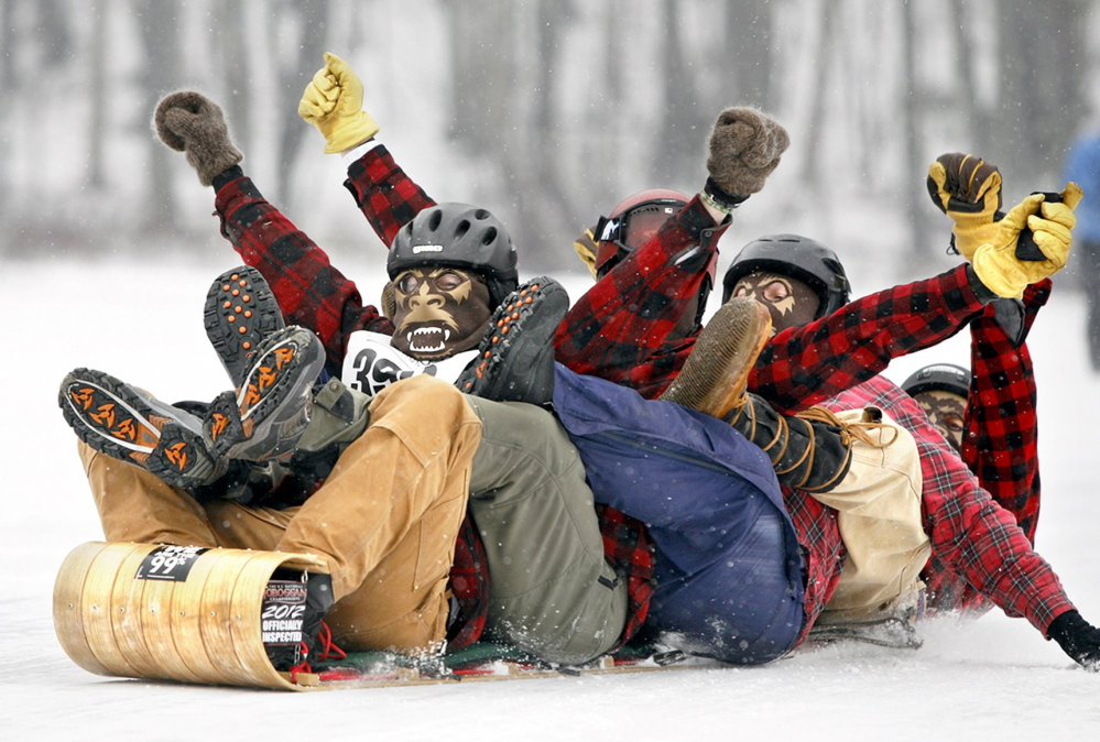 A team celebrates a successful run at a previous U.S. National Toboggan Championships. This year's event happens Saturday and Sunday at the Camden Snow Bowl.