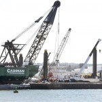 A Cashman Dredging barge is getting ready to begin work on a $9 million project that will remove up to 500,000 cubic yards of sediment in Portland Harbor.
