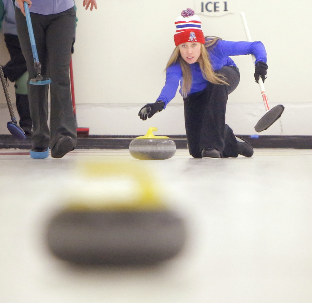 Erin Herbig of Belfast releases a stone during a curling tournament at the Belfast Curling Club in 2014.