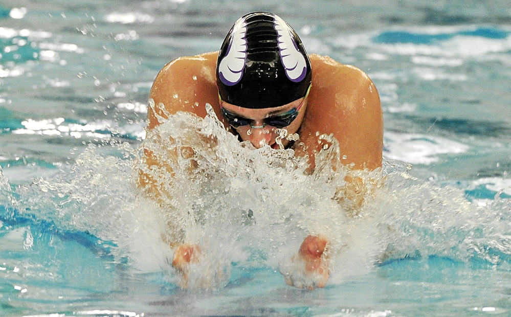 Deering's Eric Delmonte swims the breast stroke leg of the 200 medley relay. Delmonte helped Deering win the event, then won the 200 individual medley and set a meet record in the 100 breast stroke with a time of 59.67 seconds.