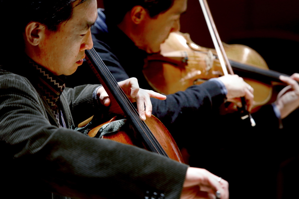 The Yings, here playing together at Studzinski Recital Hall at Bowdoin College during a recent visit to Brunswick, are members of the Ying Quartet with their sister Janet Ying on violin and Ayano Ninomiya as first violin. The quartet is among the world's leading chamber music ensembles, having won one Grammy Award and been nominated multiple times.