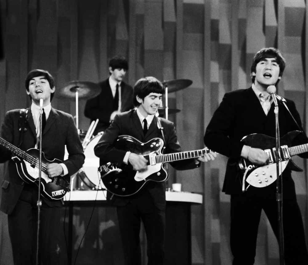 "In this Feb. 9, 1964 photo, The Beatles, from left, Paul McCartney, Ringo Starr on drums, George Harrison and John Lennon, perform for the CBS ""Ed Sullivan Show"" in New York, as they record a set that would later be shown on the Feb. 23 broadcast of the show. The Beatles made their first broadcast appearance on ""The Ed Sullivan Show,"" America's must-see weekly variety show, later in the day, Sunday, Feb. 9, 1964, officially kicking off Beatlemania."