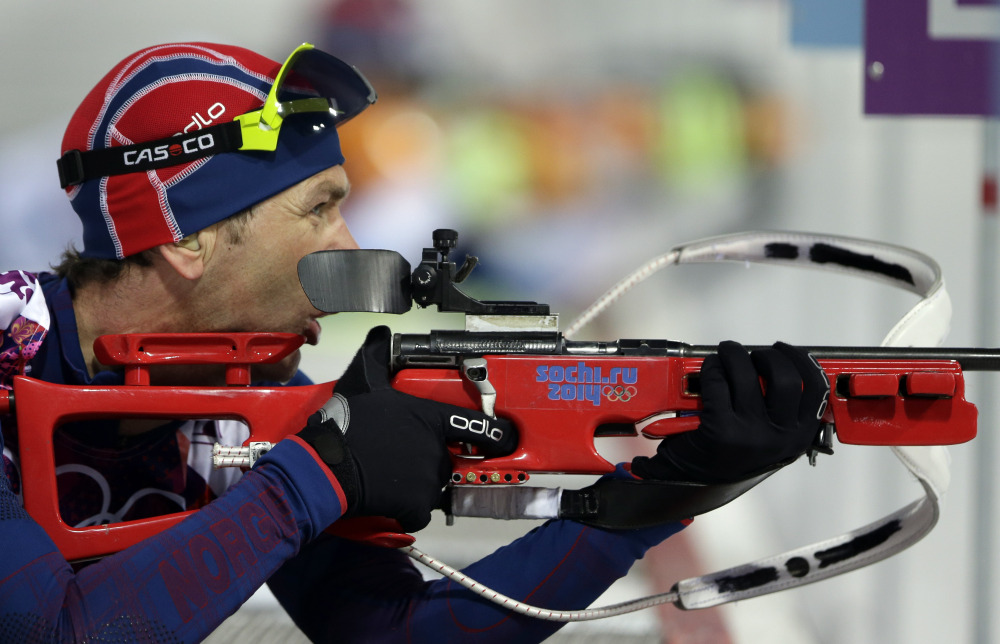 Norway's Ole Einar Bjoerndalen gets ready to shoot during the men's biathlon 10k sprint at the 2014 Winter Olympics on Saturday in Krasnaya Polyana, Russia.