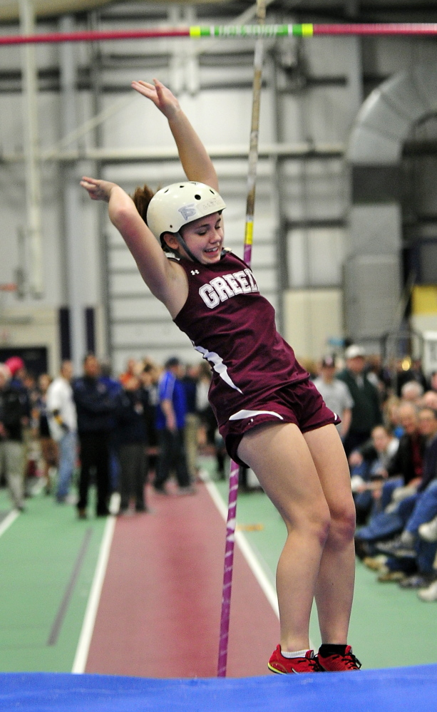 Sophie McMonagle from Greely happily clears 8' in the pole vaule for second place in the Girls Pole Vault at the Western Maine Conference Indoor Track Championships. Saturday, February 8, 2014. Gordon Chibroski, Staff Photographer