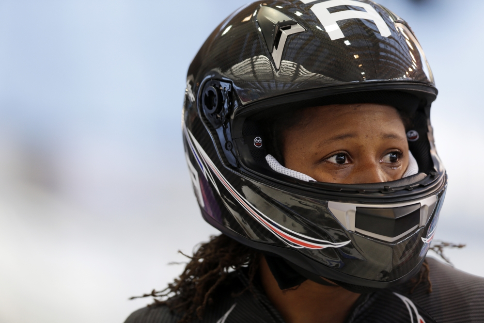 Lauryn Williams with the United States team, gets out of her sled after a training run for the two-man bobsled at the 2014 Winter Olympics,