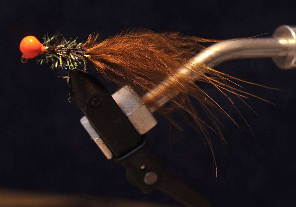 Simple and inexpensive, Macauley Lord's jig-style streamer fly is a proven seducer of trout and bass. The master tyer says flies need not be pristine, intricate or fancy because when's all said and done, the fish are rather stupid.