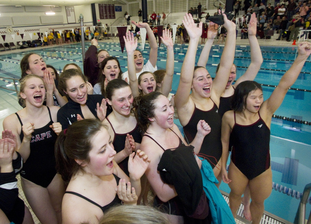 Cape Elizabeth swimmers celebrate Saturday after they edged Greely to successfully defend their title at the girls' North Southwesterns.