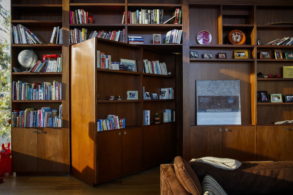 The rotating bookcase, with a TV on the reverse side, was a feature home owner Paul Lieberstein asked architect Peter Grueneisen to include in his design.