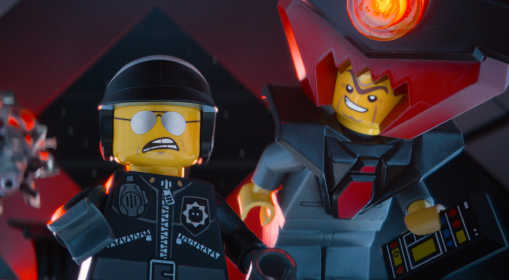 "This image from ""The Lego Movie"" shows the character Bad Cop/Good Cop, voiced by Liam Neeson, left, and President Business, voiced by Will Ferrell, in a scene."